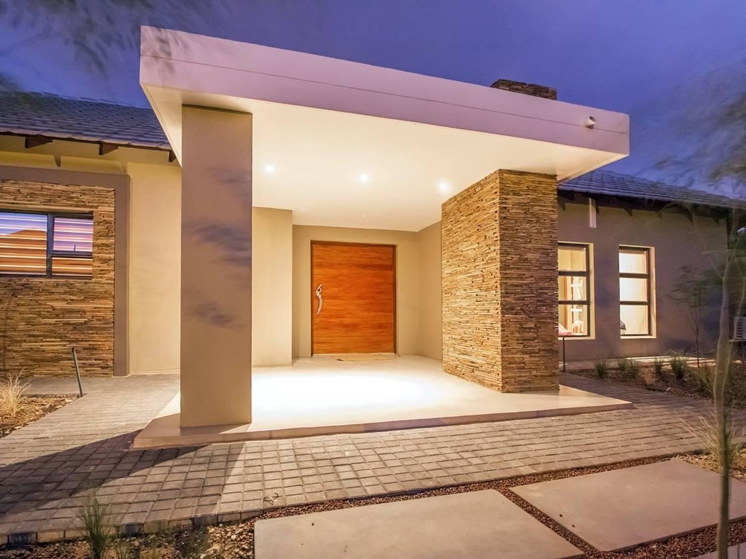 Una casa con una entrada impresionante y un interior lleno de ideas