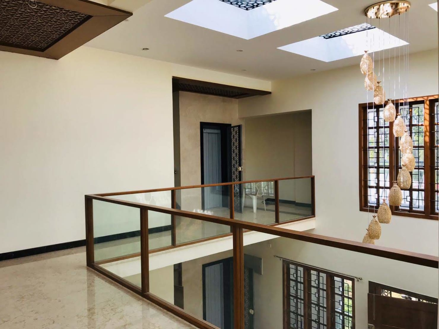 Mr. Nataraja Residential:  Living room by Geometrixs Architects & Engineers