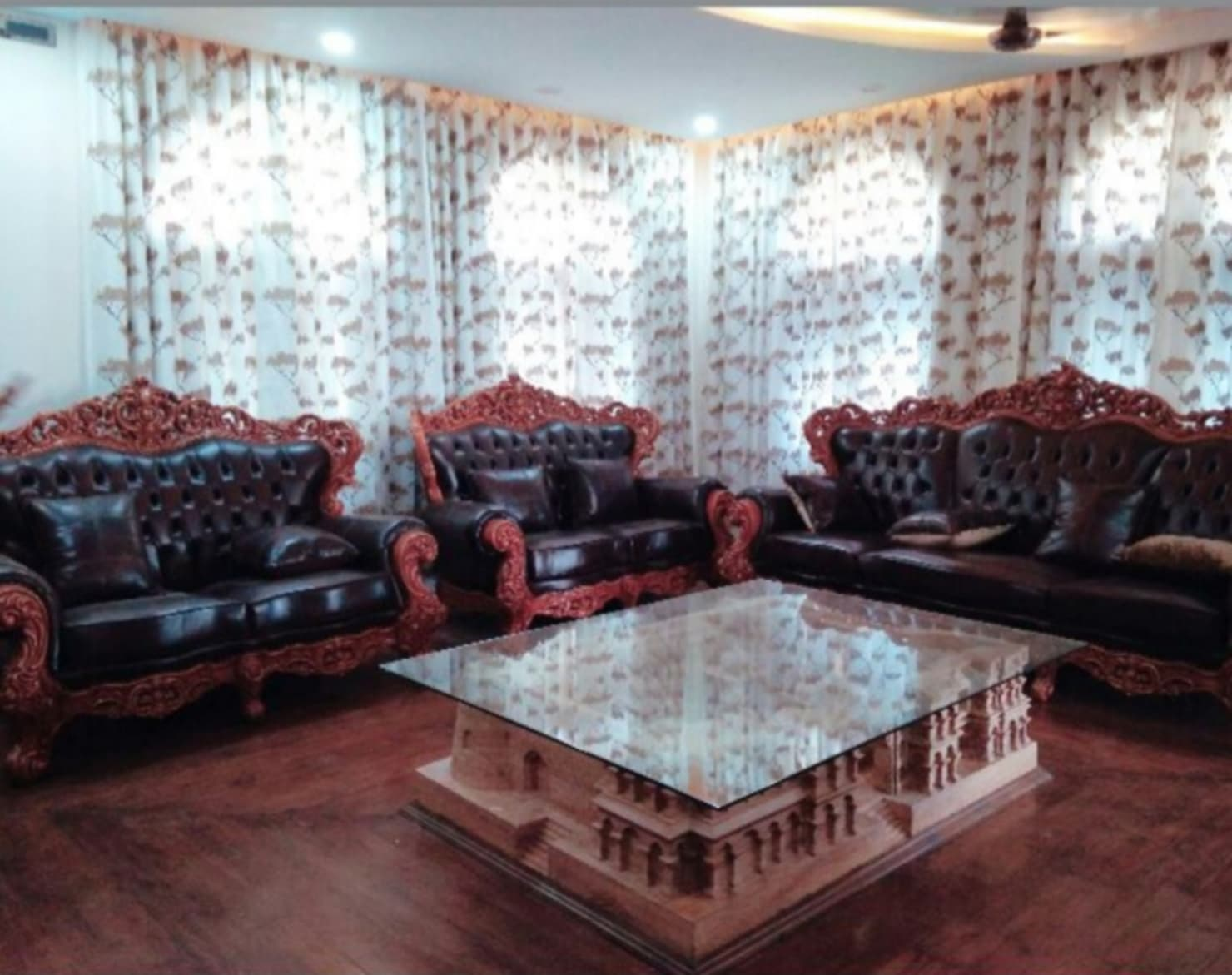 Elaborate home interiors and lawn designs from a home in Indore
