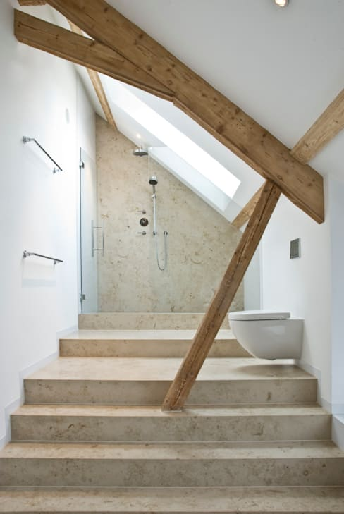 Baños de estilo  de Pientka - Faszination Naturstein