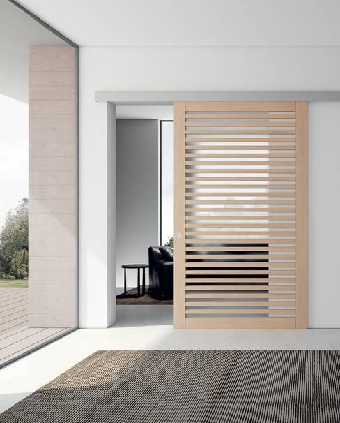 Projekty,  Korytarz, przedpokój zaprojektowane przez MOVI ITALIA SRL