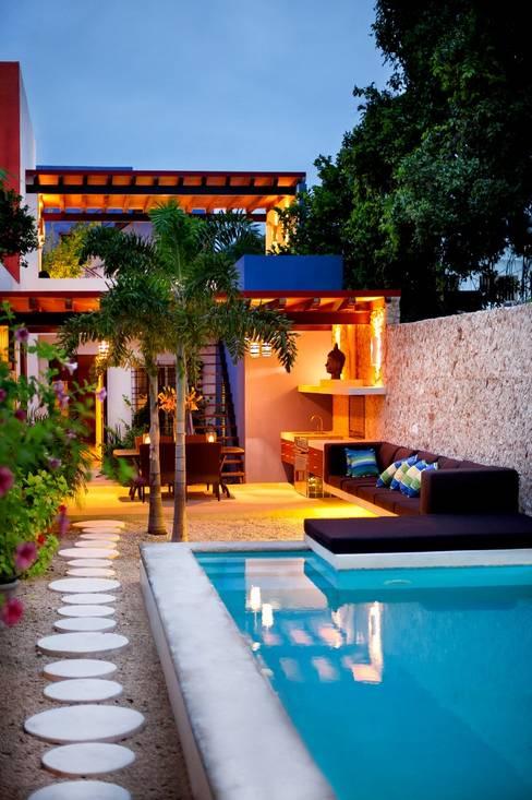 Houses by Taller Estilo Arquitectura