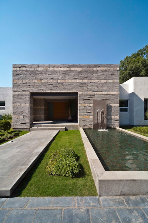 Casa Valle:  de estilo  por Arquiplan