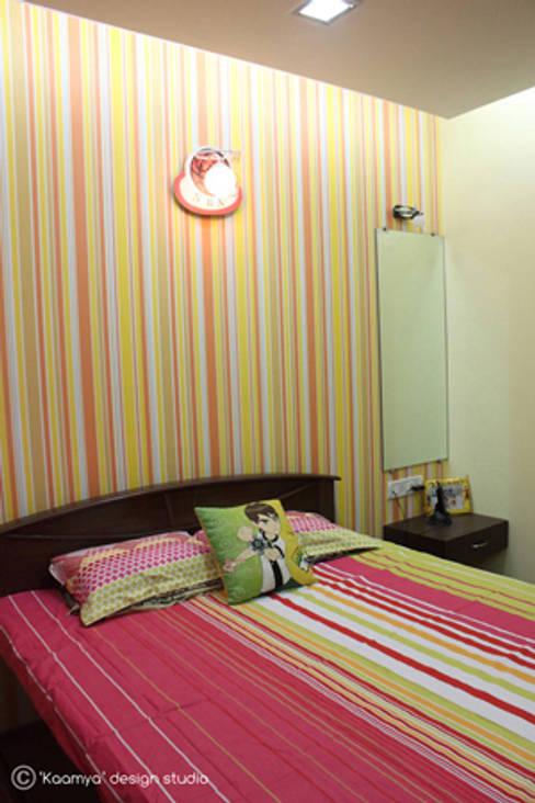 Kids bedroom:   by kaamya design studio