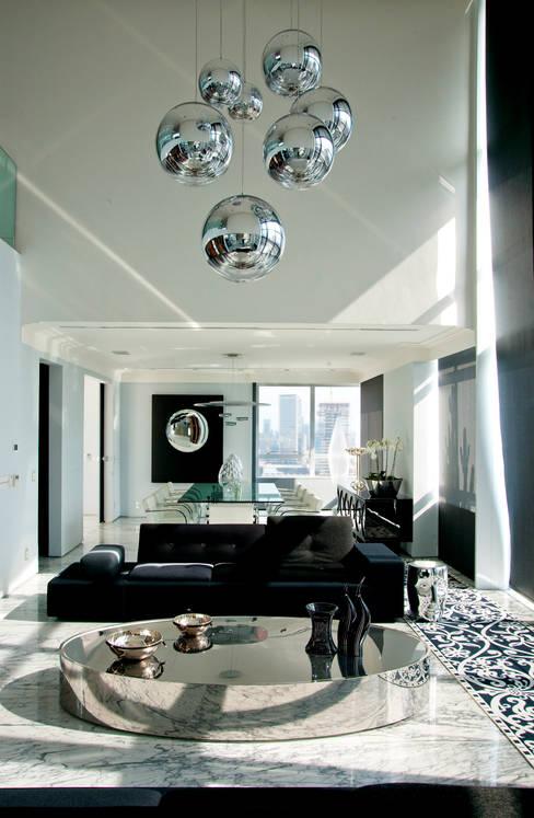 Duplex Cidade Jardim - São Paulo: Salas de estar  por Brunete Fraccaroli Arquitetura e Interiores