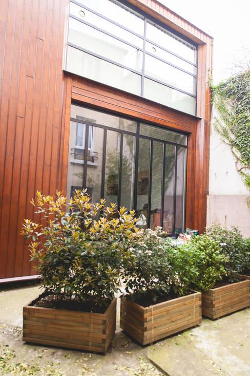 Loft : Maisons de style  par Lise Compain