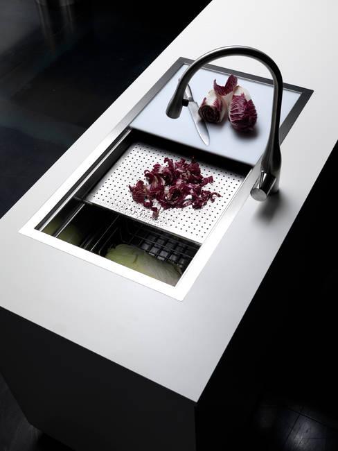 Segno per Effeti: Cucina in stile  di Vegni Design