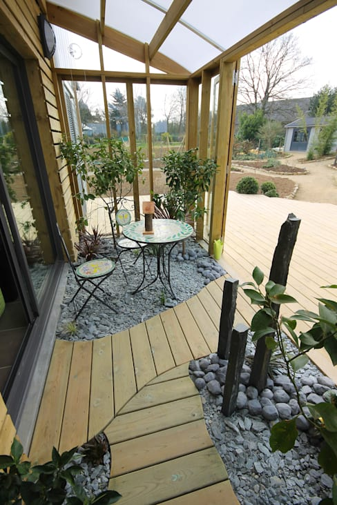 Jardines de invierno de estilo  por Patrice Bideau a.typique