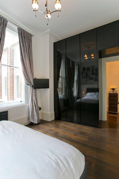 Dormitorios de estilo  por Temza design and build