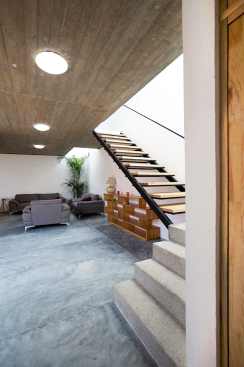 Living room by rOOtstudio