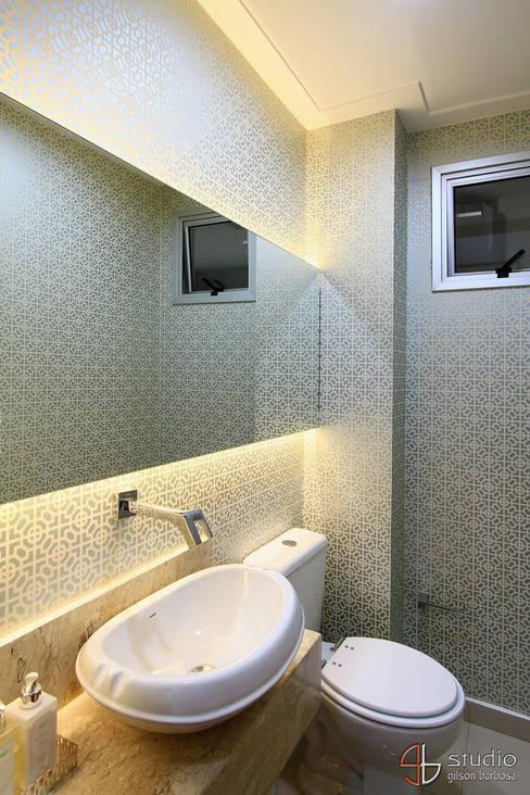 Lavabo: Banheiros  por Camila Tannous Arquitetura & Interiores