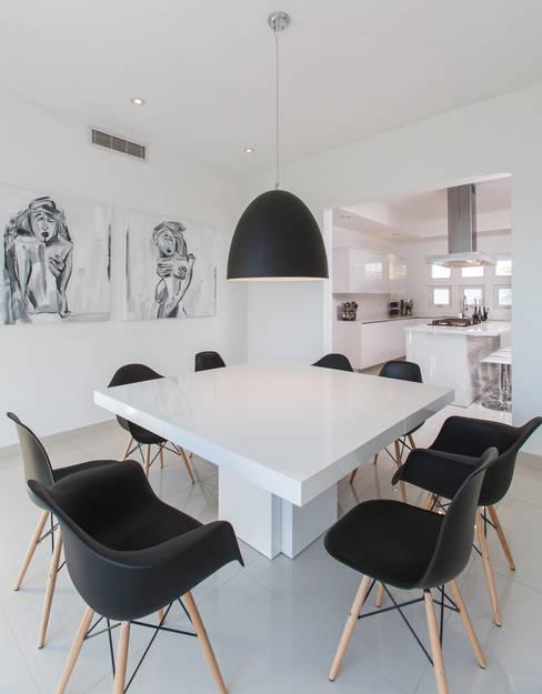 Projekty,  Jadalnia zaprojektowane przez Grupo Arsciniest
