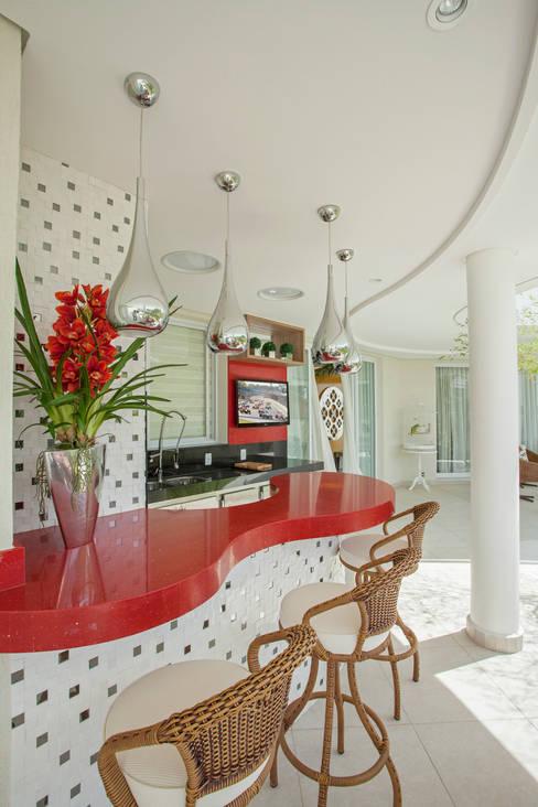 Jardin de style  par Designer de Interiores e Paisagista Iara Kílaris