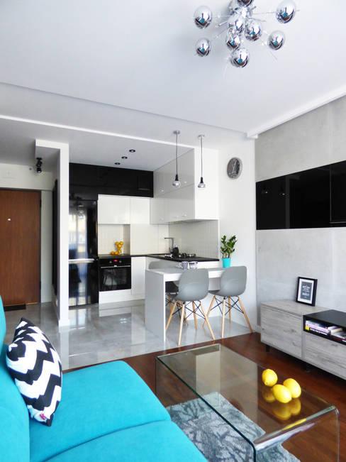 Realizacja projektu mieszkania 35m2-przed i po: styl , w kategorii Kuchnia zaprojektowany przez Interiori Pracownia Architektury Wnętrz