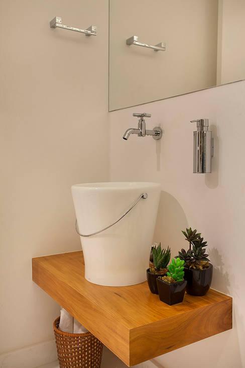 Casas de banho  por Cadore Arquitetura