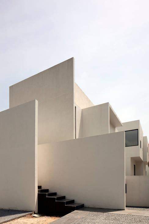 Projekty,  Domy zaprojektowane przez Lucio Muniain et al