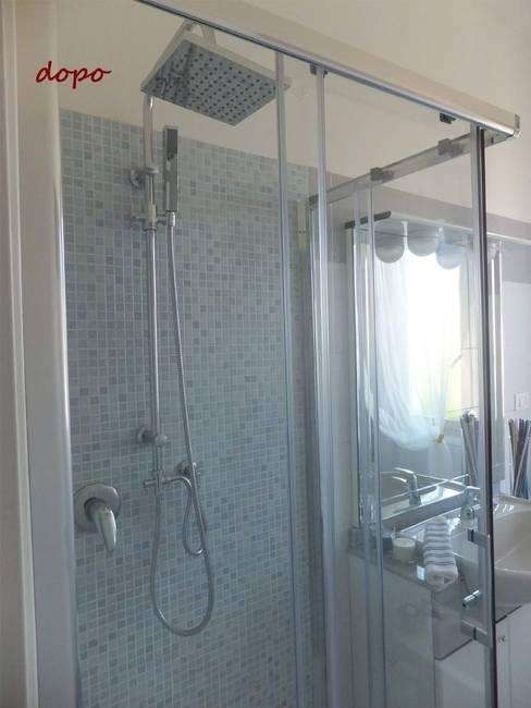New look per un appartamento di 70 mq a Terni: Bagno in stile  di EFFEtto Home Staging