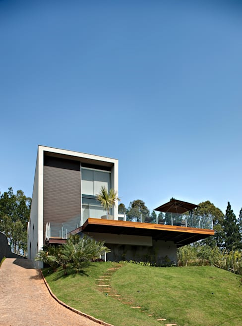 Houses by Márcia Carvalhaes Arquitetura LTDA.