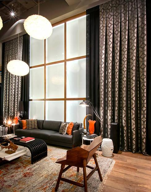 Triade Loft - Ambiente CASA COR SC 2015: Salas de estar  por Spengler Decor