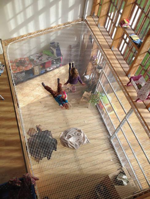 Mini/Maxi: Jardin d'hiver de style  par LAUS architectes
