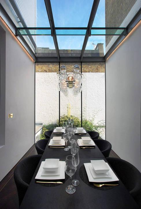 Conservatory by ÜberRaum Architects