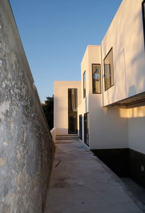 Villa G: Maisons de style  par FJA