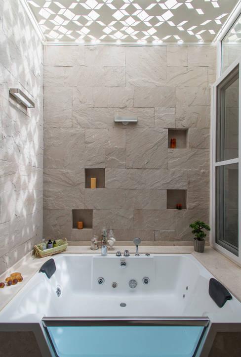 Light filtering into the Master Bathroom:  Bathroom by studio XS