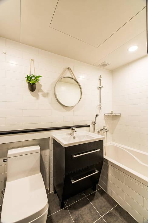 용인시 수지구 죽전동 성현마을 광명샤인빌아파트 (24평형): 아르떼 인테리어 디자인의  욕실