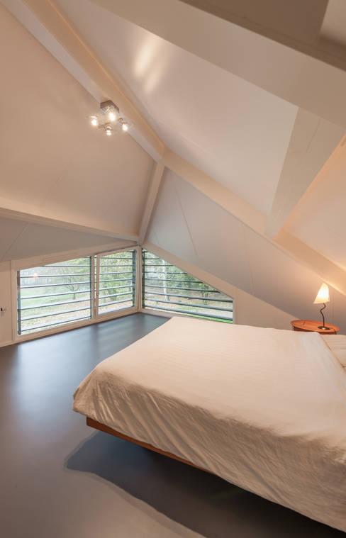 Maas Architecten의  침실