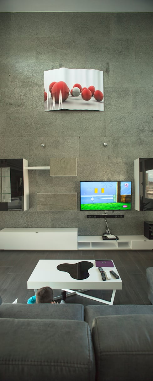 Casa AI: Salones de estilo  de Mascagni arquitectos