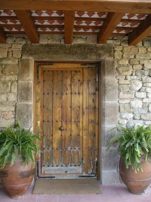 Wooden doors by Atres Arquitectes