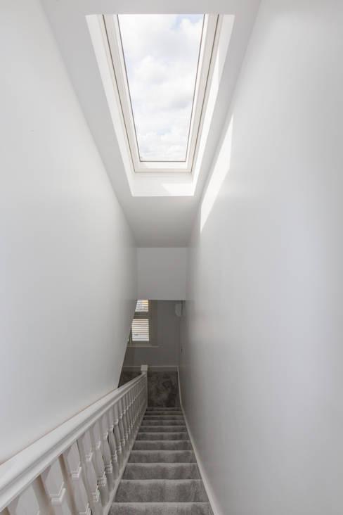 A roof window to brighten up the hallway!:  Corridor & hallway by The Market Design & Build