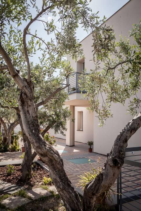 Jardins  por Studio di Architettura Ortu Pillola e Associati