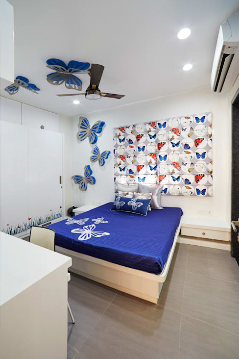 SADHWANI BUNGALOW:  Nursery/kid's room by Square 9 Designs