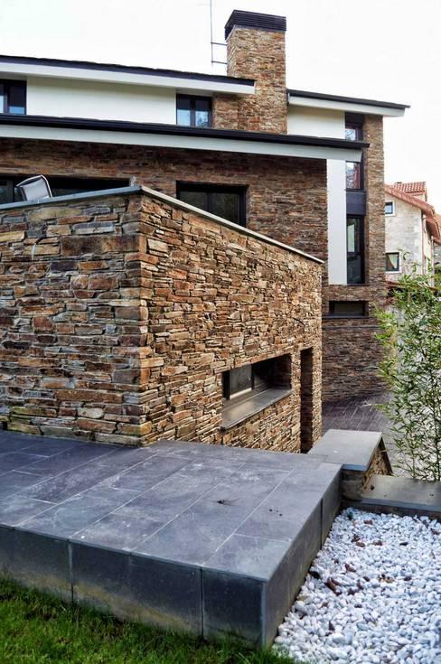 Projekty,  Domy zaprojektowane przez Intra Arquitectos