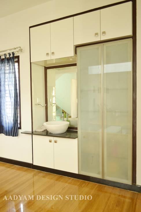 Dining room by Aadyam Design Studio