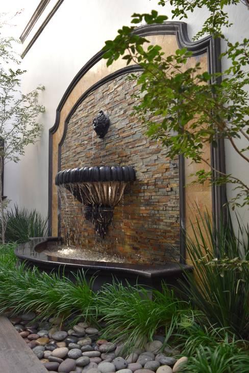 Jardines de estilo  por arketipo-taller de arquitectura