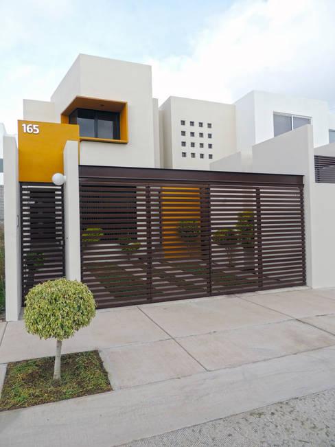 Casas de estilo  por DOOR Arquitectos