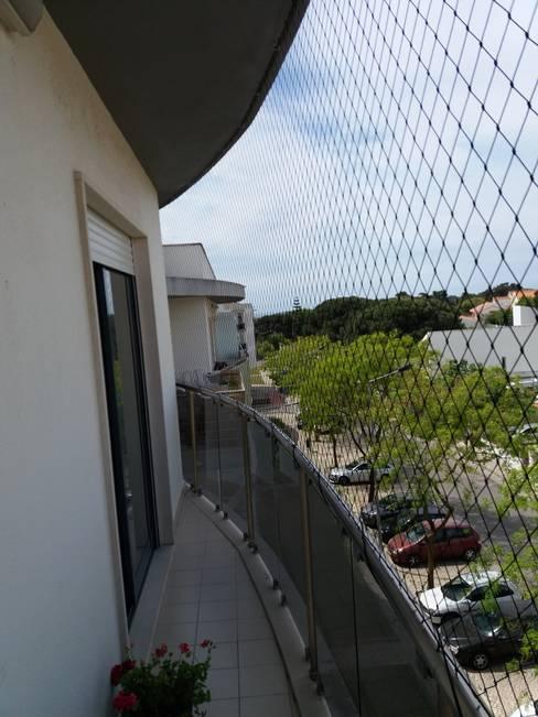 Redes de proteção para varandas: Varandas  por ANTIKEDA