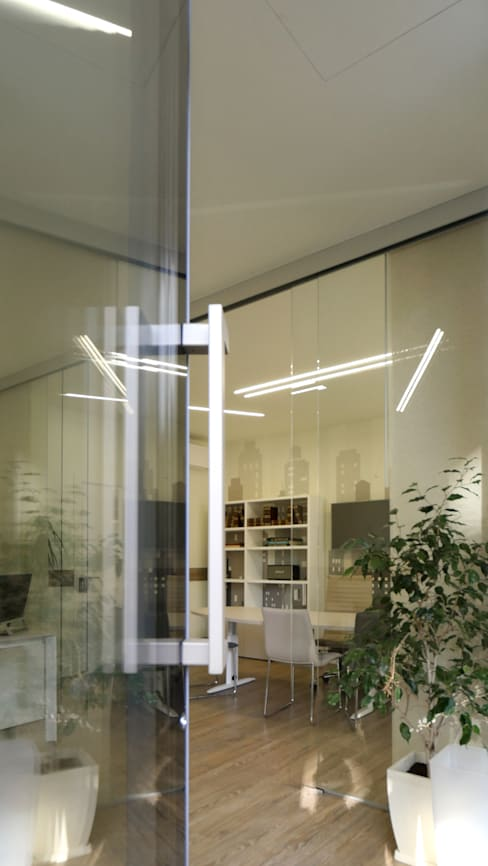 entrando nello Studio Immobiliare: Negozi & Locali commerciali in stile  di Pamela Tranquilli Interior Designer