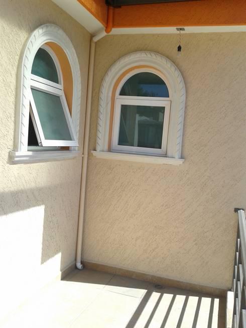 Cantera en ventanas: Casas de estilo  por DD Arquitectos