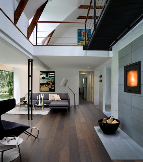 Paredes y pisos de estilo  por Lignum Möbelmanufaktur GmbH