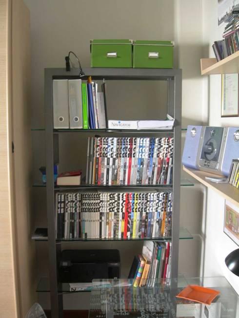 Scrivania e Libreria in ferro e vetro: Studio in stile  di Studio Pierpaolo Perazzetti