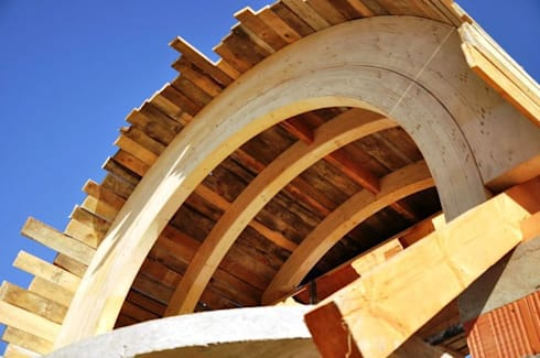 Glulam arches used in construction:  Garden by EcoCurves - Bespoke Glulam Timber Arches