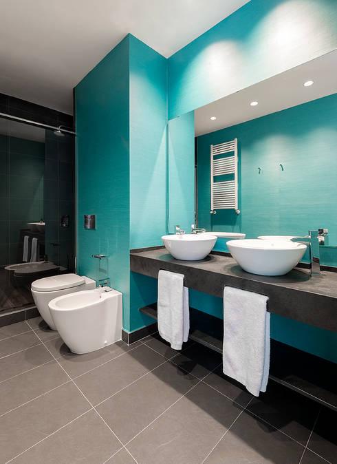 VIVIENDA EN RUZAFA (VALENCIA): Baños de estilo  de Cota Cero Interiorismo