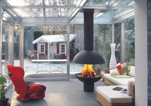 Mezzofocus Fire: modern Living room by Diligence International Ltd