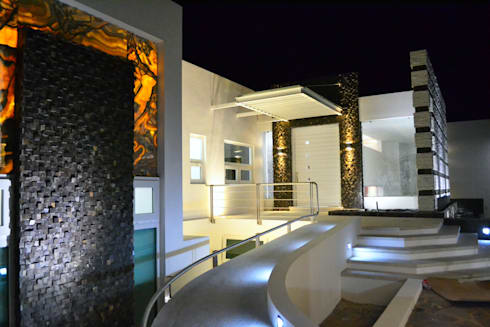 INGRESO PRINCIPAL: Casas de estilo moderno por ro arquitectos