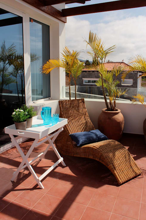 Decoración villa: Terrazas de estilo  de Tatiana Doria,   Diseño de interiores