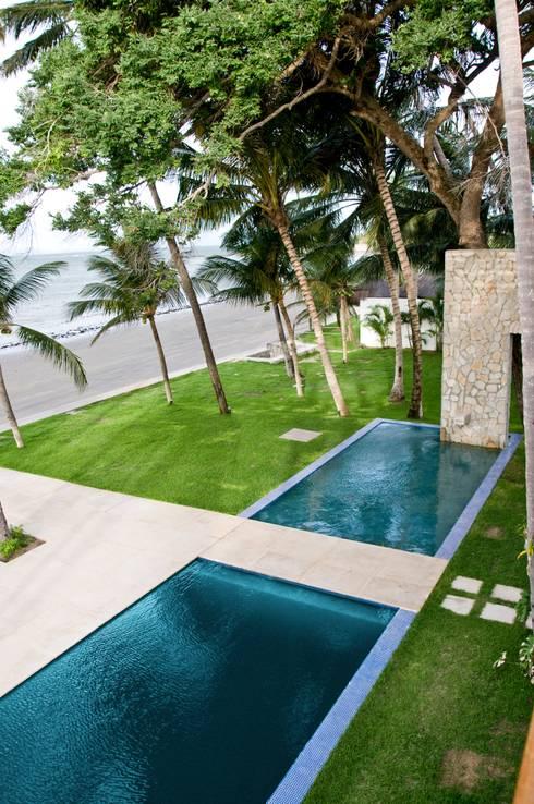 Piscinas tropicais por Renato Teles Arquitetura