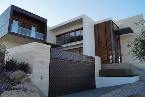 Casa Misión: Casas de estilo moderno por Metrik Studio